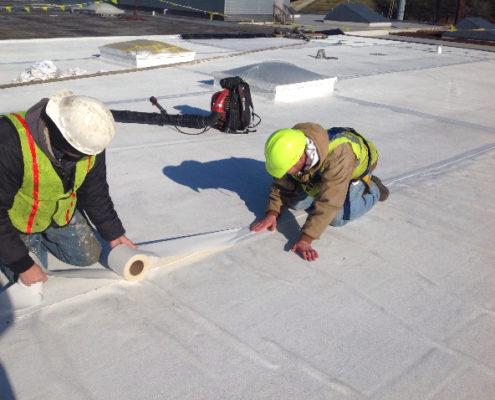 Roofing Crew Repairing Roof
